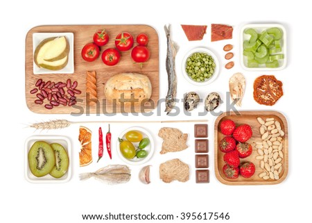 still life with food that causes allergies on white background top view