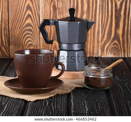 still life with fresh espresso coffee cup, pot and beans