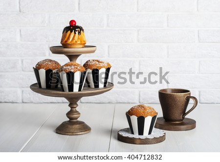 Still life with fresh muffins on the kitchen table - stock photo