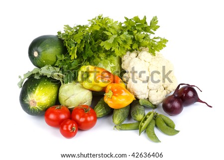 Still-life with fresh vegetables on a white background.