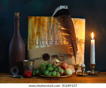 still life with fruit, old letter with a feather pen and a candle