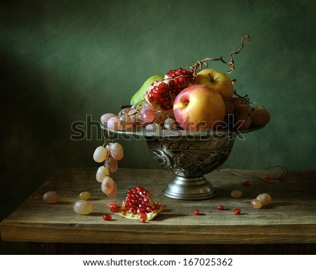 Still life with fruit on a tin plate - stock photo