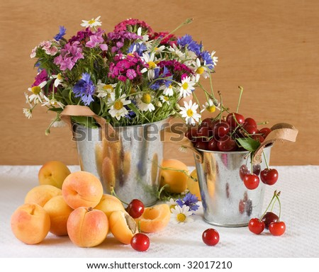 Still life with fruits and wild flowers - stock photo