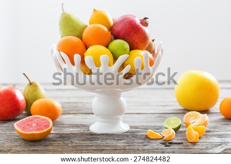 still life with fruits in vase - stock photo