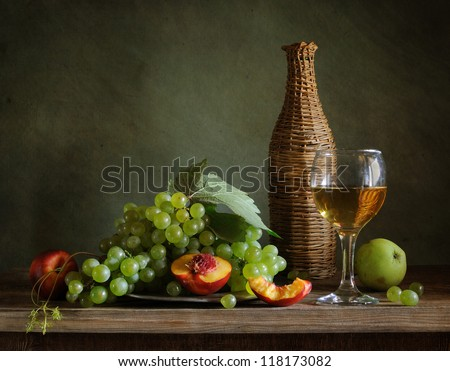 Still life with grapes and a glass of wine - stock photo
