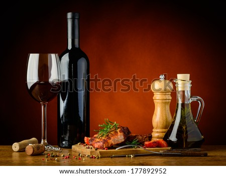 still life with homemade traditional grilled steak and red wine - stock photo