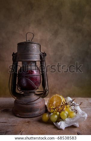 Still life with lantern and grapes with lemon