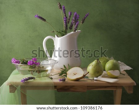 Still life with lavender flowers and pears - stock photo