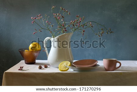 Still life with lemons and a cup of tea - stock photo