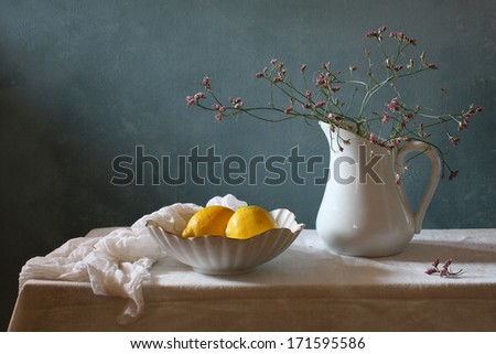 Still life with lemons and spring flowers - stock photo