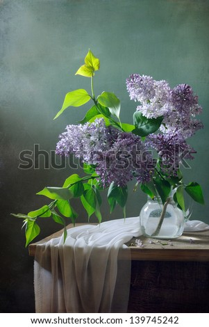 Still life with lilacs and drapery - stock photo