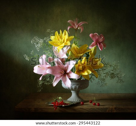 Still life with lilies and berries - stock photo
