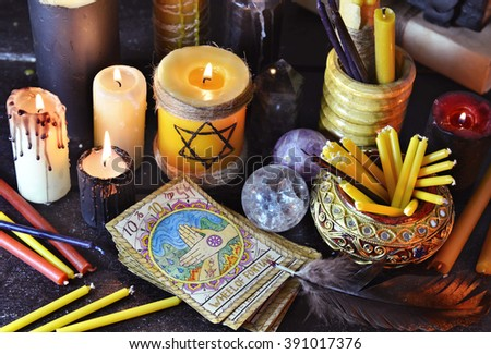 Still life with magic objects, evil candles and the tarot cards. Fortune telling seance or black magic ritual. Scary still life with occult and esoteric symbols. Halloween or divination rite - stock photo