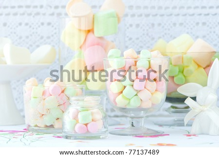 Still life with many marshmallow candies into a glass - stock photo