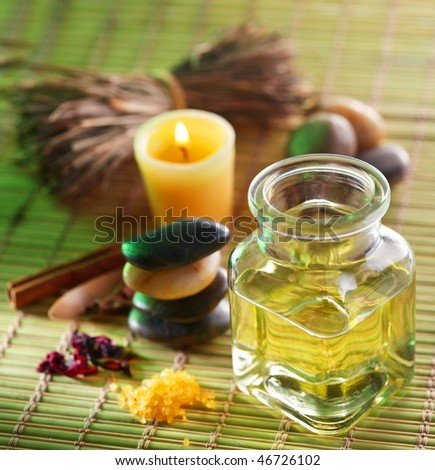 Still life with massage oil in the spa salon - stock photo