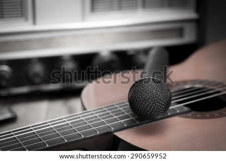 Still life with Microphone and classic guitar on vintage Radio  background,vintage style - stock photo