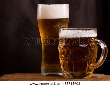 still life with mug and glass of beer