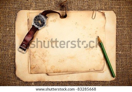 Still-life with old blank papers and wristwatch - stock photo