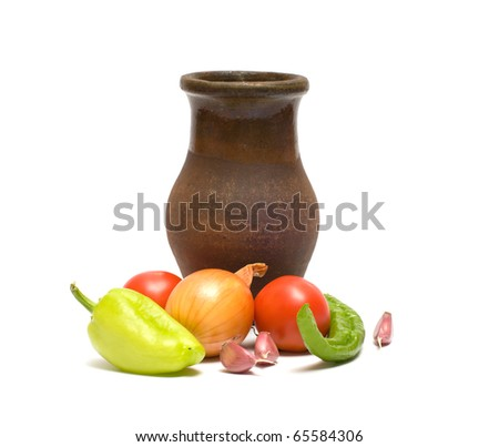 Still life with old clay jug on a white background. - stock photo