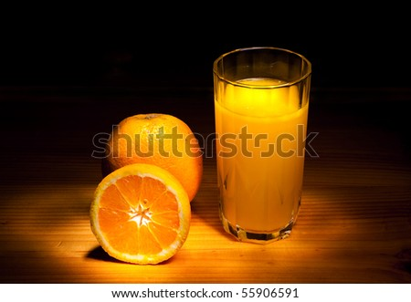 still life with oranges and orange juice cup - stock photo