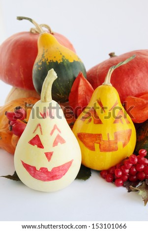 Still-life with painted halloween pumpkins on white - stock photo