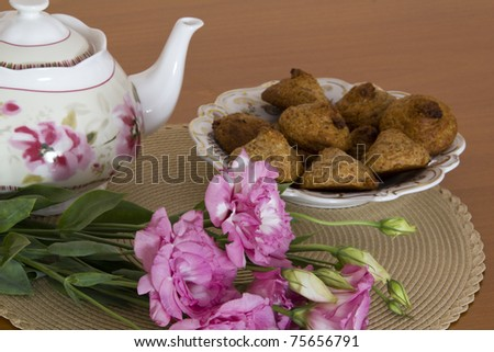Still life with Passover Peanut cookies Teapot and flowers - stock photo