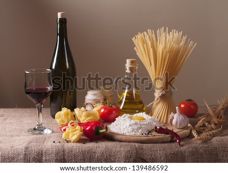 still life with pasta, vegetables and wine