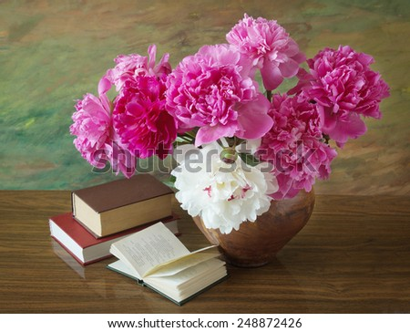 Still life with peony flowers and books on artistic background - stock photo