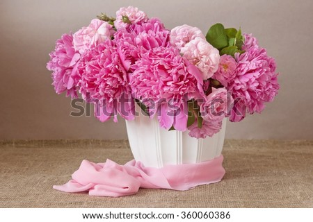 Still life with peony flowers on artistic background - stock photo