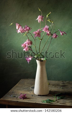 Still life with pink flowers - stock photo