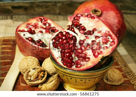 still life with pomegranate - stock photo