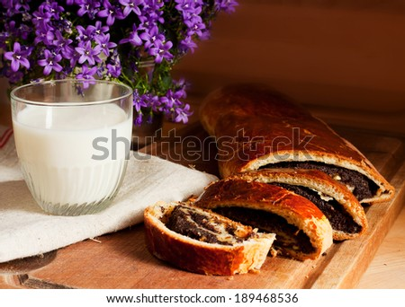 Still life with poppy seed roll  - stock photo