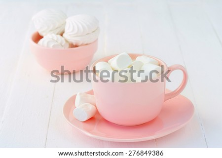 Still life with porcelain pink crockery full of marshmallow souffle - stock photo