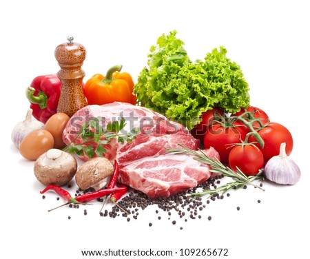 Still life with raw pork meat and fresh vegetables isolated on white - stock photo