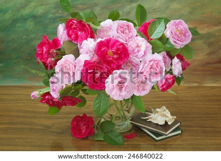 Still life with red and pink roses bunch, sea shell and  books on artistic background. Teacher's day concept - stock photo