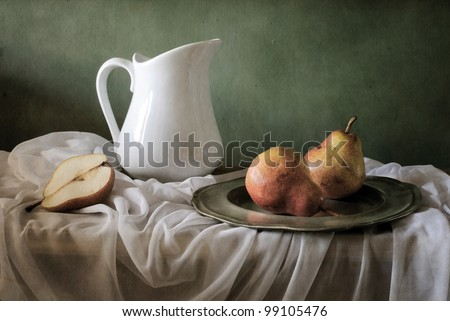 Still life with red pears and a jar - stock photo