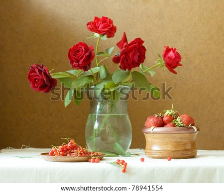 Still life with red velvet roses, strawberries and currants - stock photo