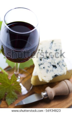 Still life with red wine and cheese - stock photo