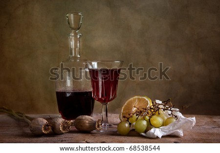 Still life with red wine and grapes with lemon