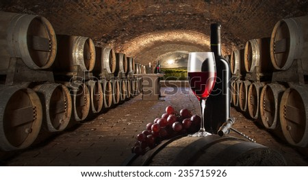 still life with red wine in old wine cellar