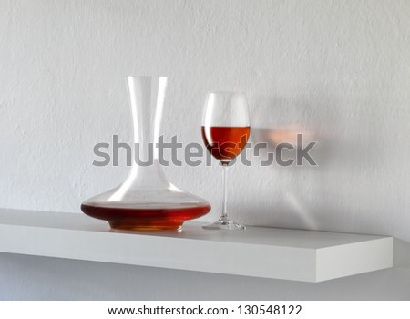 still life with red wine on white background - stock photo