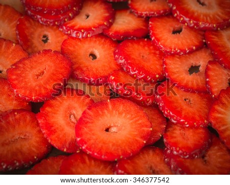 Still life with ripe juicy strawberries in slices - stock photo