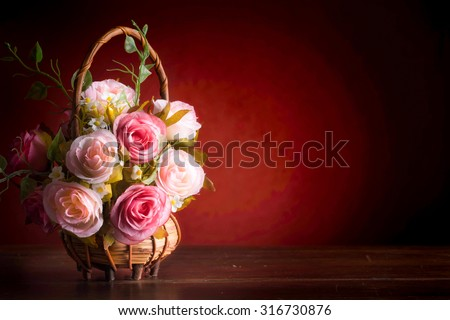 Still life with roses on wood desk vintage - stock photo