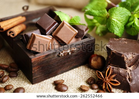 Still life with set of chocolate on burlap cloth, closeup - stock photo