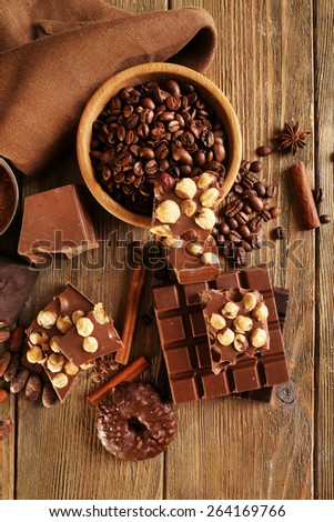 Still life with set of chocolate on wooden table, top view - stock photo
