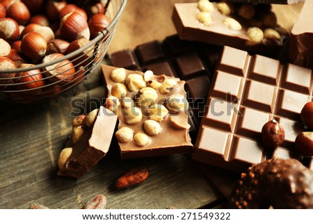 Still life with set of chocolate with nuts, closeup