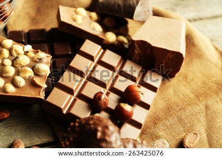 Still life with set of chocolate with nuts on burlap cloth, closeup - stock photo