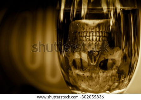 still life with skull and  grape wine on abstract background