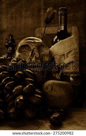 still life with skull and  grape wine on grunge background