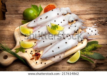 Still life with squid and various ingredients - stock photo